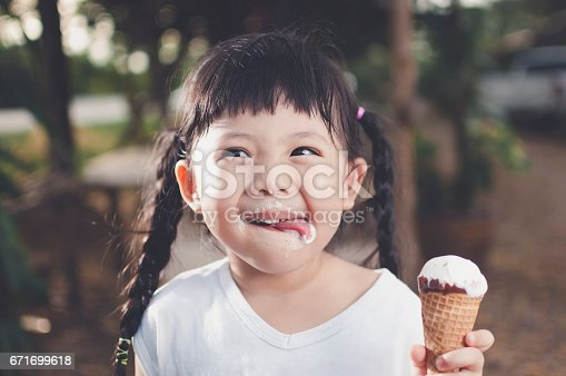 Asia Girl eating ice cream.