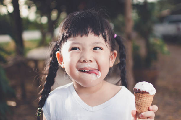 Asia Girl eating ice cream. stock photo