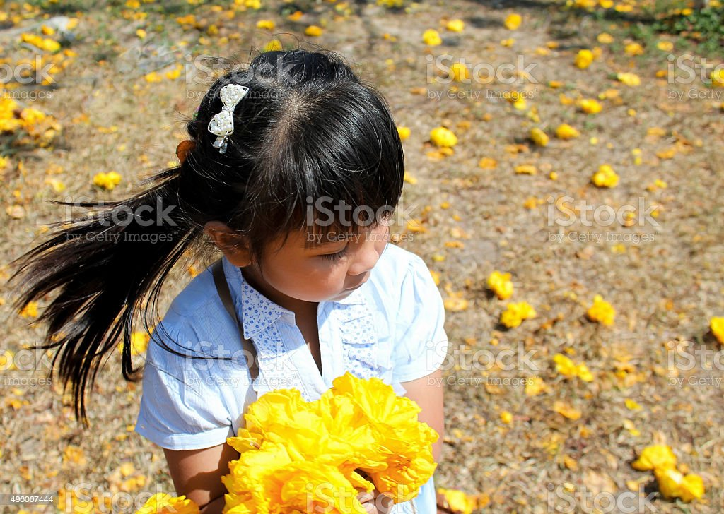 Asia Girl take yellow flowers in garden
