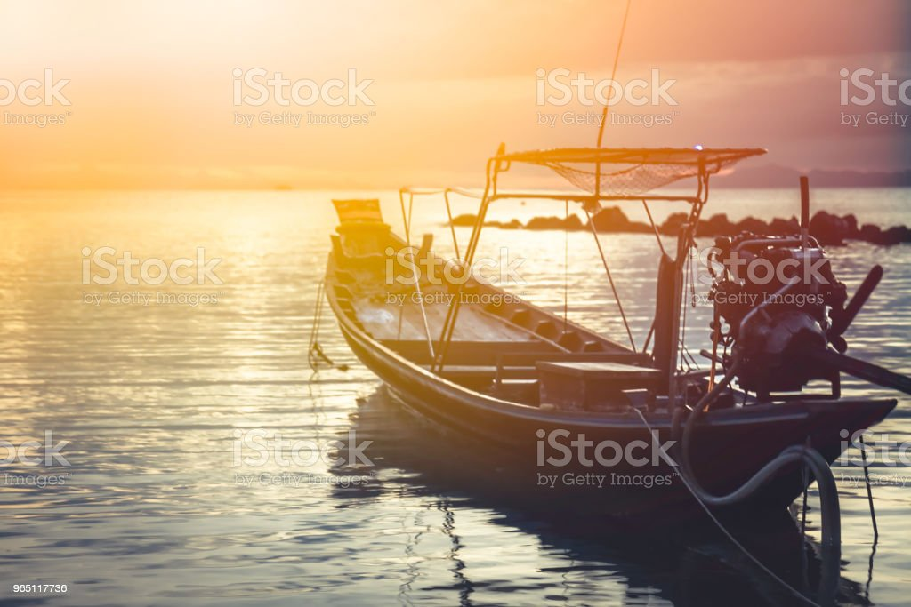 Asia lifestyle landscape sea sunset boat horizon orange sky royalty-free stock photo