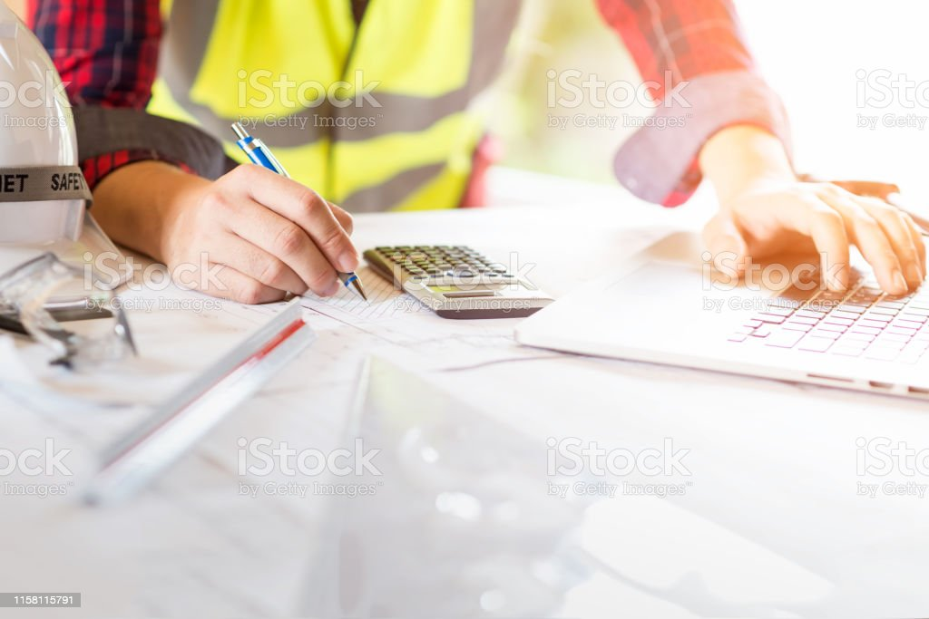 Asia man architect or engineer working in office, Construction...