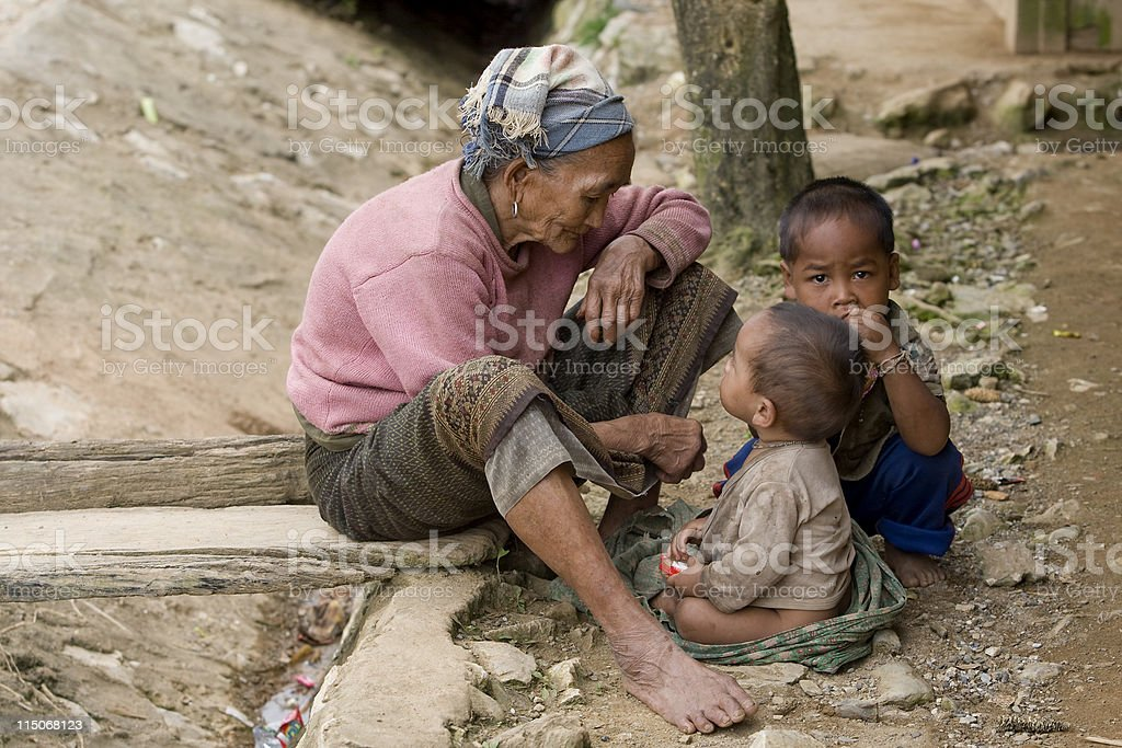Asia, old woman with grandchildren stock photo
