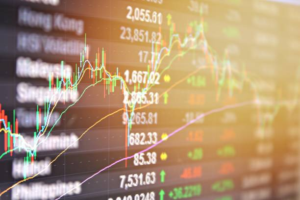 Asia Pacific stock market data and candle stick graph chart on monitor stock photo
