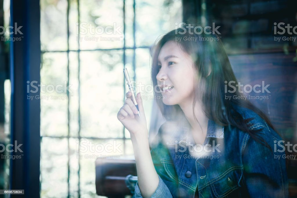 Asia teenage hipster happy in cafe. stock photo