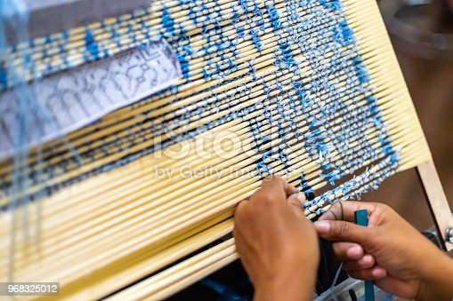 Asia Woman Procedure Making Thai Silk Pattern weaving in small weaving mill in Thailand