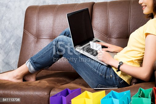 184640907istockphoto Asia woman shopping online at home. Searching product in shoppin 541113706