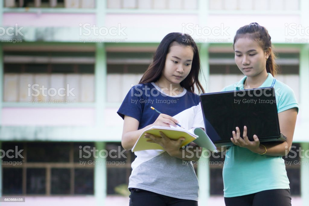 asia women and learn stock photo