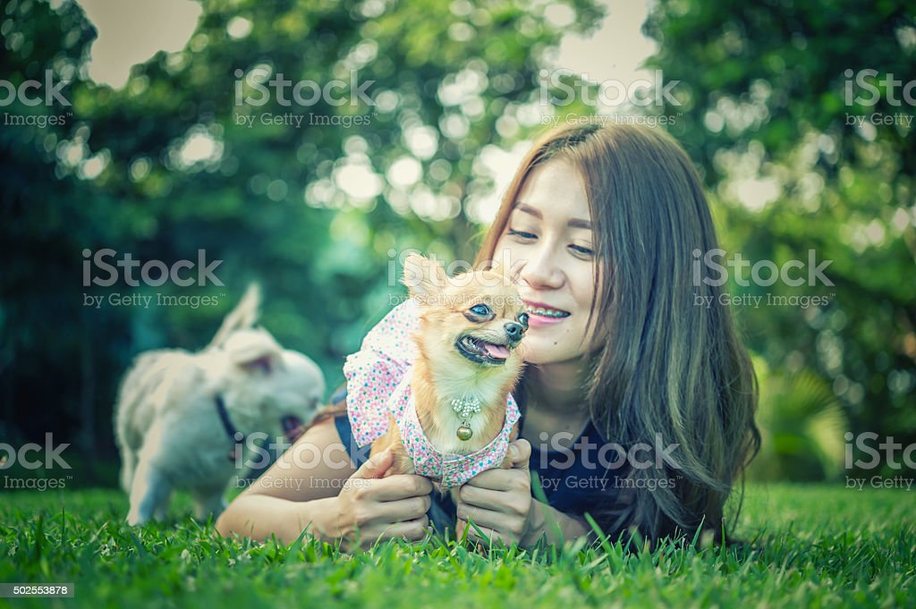 Asia Young Women With Lovely Dog Stock Photo - Download