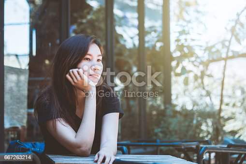 istock Asia youth teenager sitting depression on chair. Lifestyle people concept in cafe. 667263214