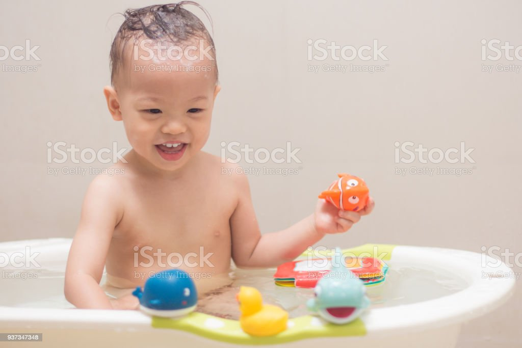 Asian 18 Months 1 Year Old Toddler Baby Boy Child Taking A Bath At ...