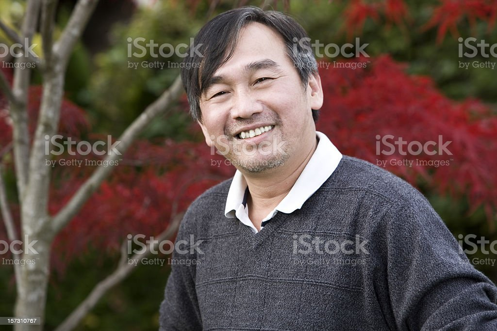 Asian Adult Man Portrait Outdoors in Japanese Garden, Copy Space stock photo