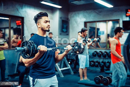 istock Asian Adult Man working out at the Gym 1155231782