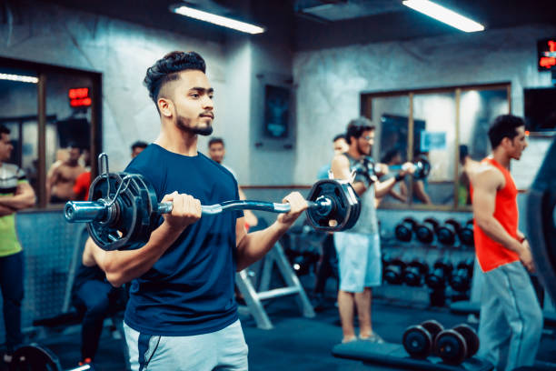 Asian Adult Man working out at the Gym stock photo