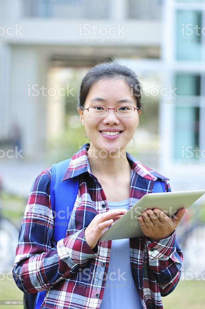 asian adult student use tablet in campus royalty-free stock photo