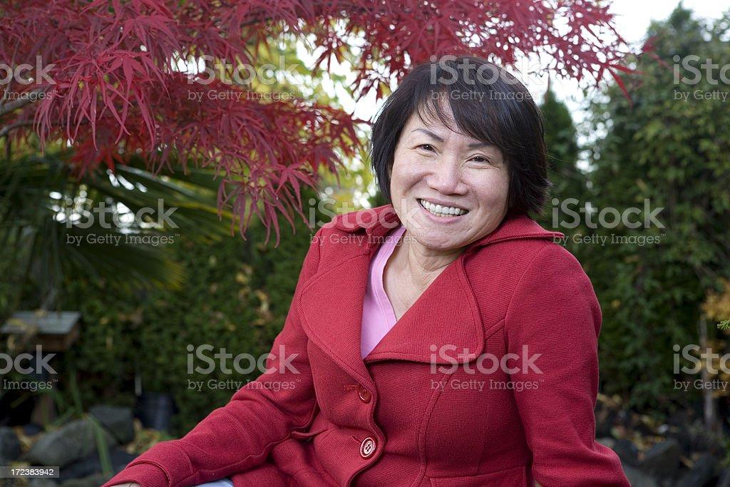 Asian Adult Woman Smiling Portrait Near Maple Tree Outside, Copyspace stock photo
