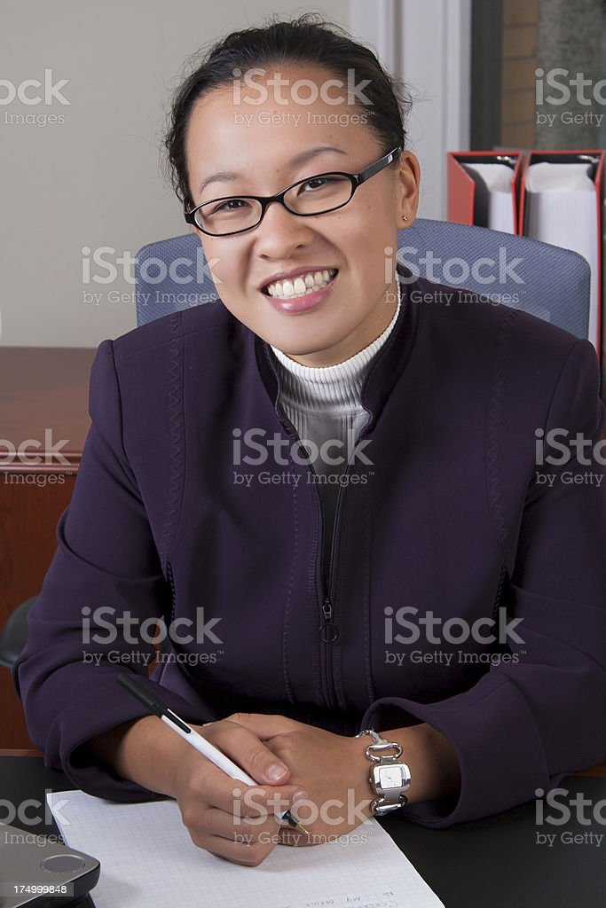 Asian American Business woman smiling at camera royalty-free stock photo