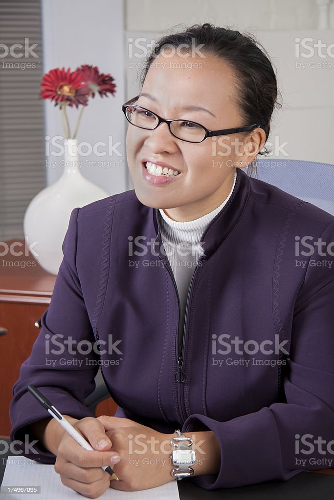 Asian American Business woman smiling - close royalty-free stock photo