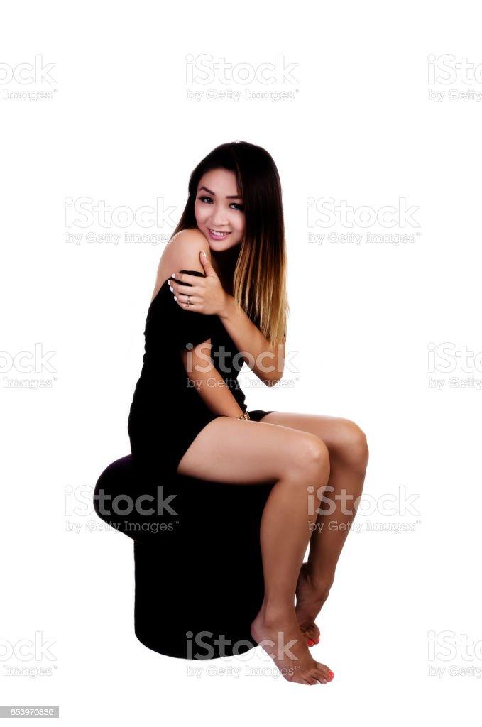 Amazing Asian American Woman Sitting On Stool In Black Dress Stock Lamtechconsult Wood Chair Design Ideas Lamtechconsultcom