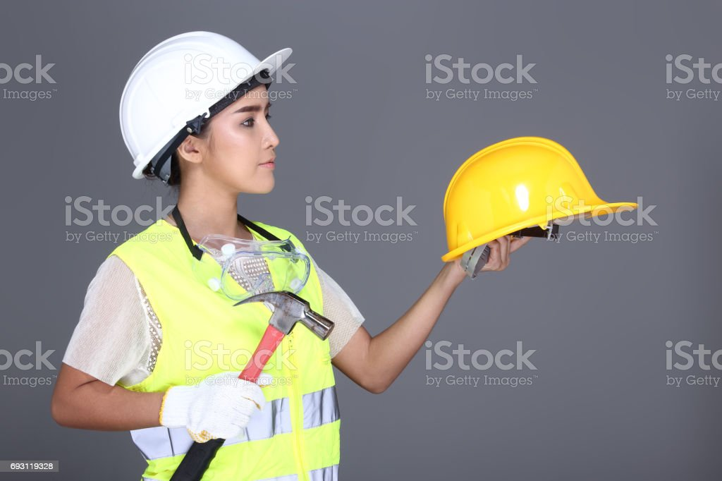 asian architect engineer woman in white hard hat safety vast