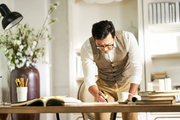 asian architet working in home office stock photo