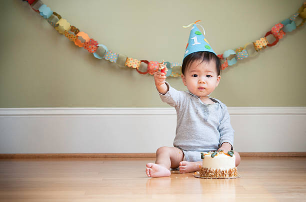 Asian baby celebrating his First Birthday stock photo