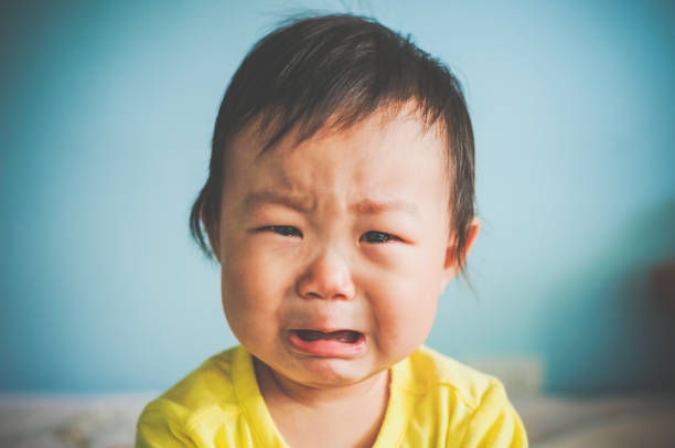 A Asian baby crying A Asian baby girl crying at home crying stock pictures, royalty-free photos & images
