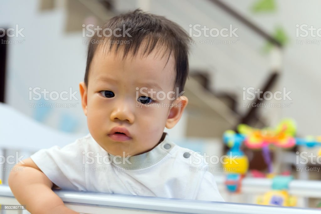 Asian baby cute boy in crib stock photo