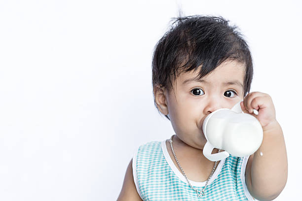 Asian baby drinking milk from Baby bottle stock photo