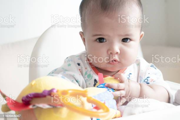 Asian baby girl playing with her lion doll on white high chair picture id1163943047?b=1&k=6&m=1163943047&s=612x612&h=wllx2 coobhhn sr5ammjbijjsqxaer2jrsjjoq7fo8=