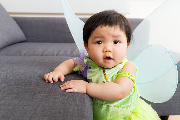 Asian baby girl wearing a halloween party costume Asian baby girl wearing a halloween party costume peter pan stock pictures, royalty-free photos & images