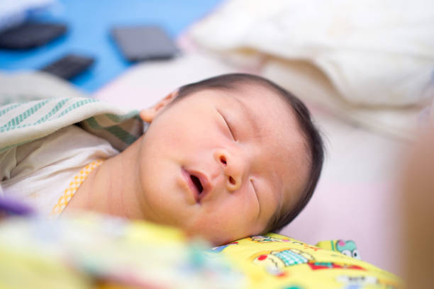 Asian Baby Sleep with Mouth Open stock photo