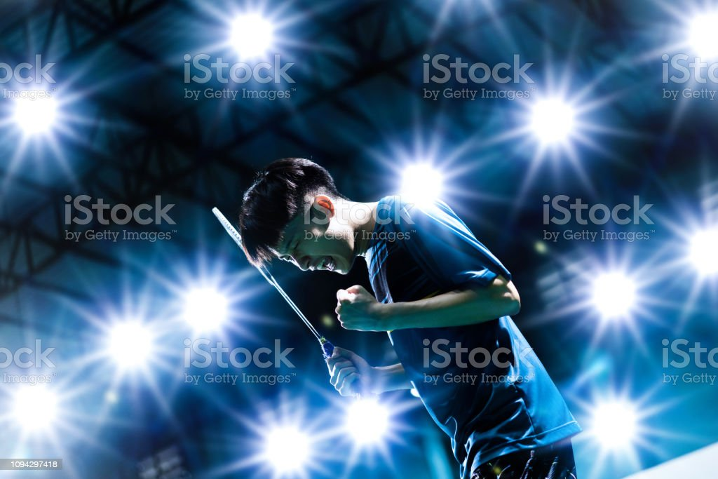 Cтоковое фото Asian badminton player is glad he scored
