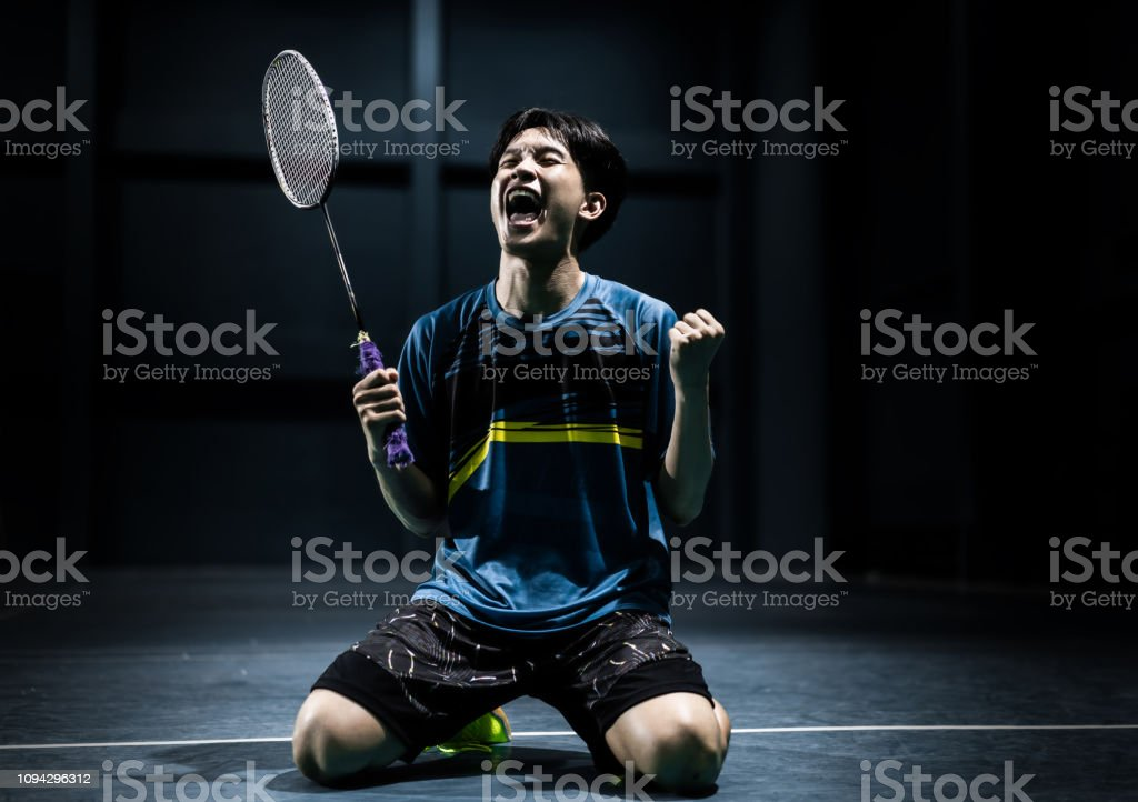 Cтоковое фото Asian badminton player is glad that he wins competition