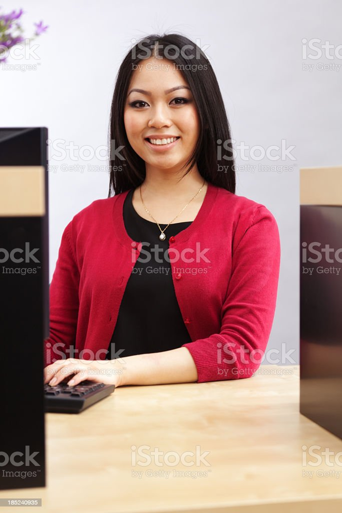 Asian Bank Teller at Banking Counter, Financial Advisor Providing Service stock photo
