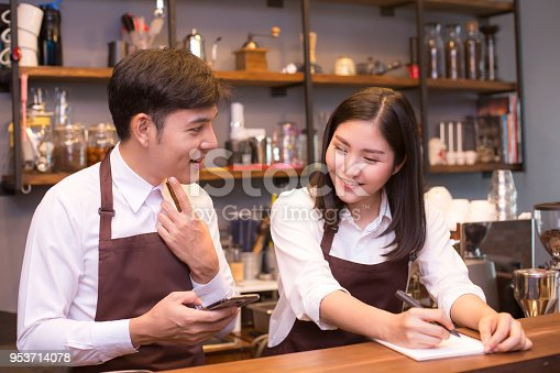 istock Asian barista making coffee in coffee shop counter.  Barista working at cafe. People working with small business owner or sme concept. 953714078