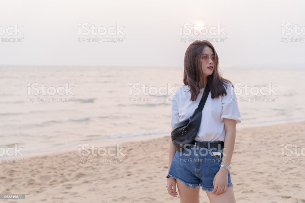 Asian beautiful female young teenager relaxing on the beach background. royalty-free stock photo