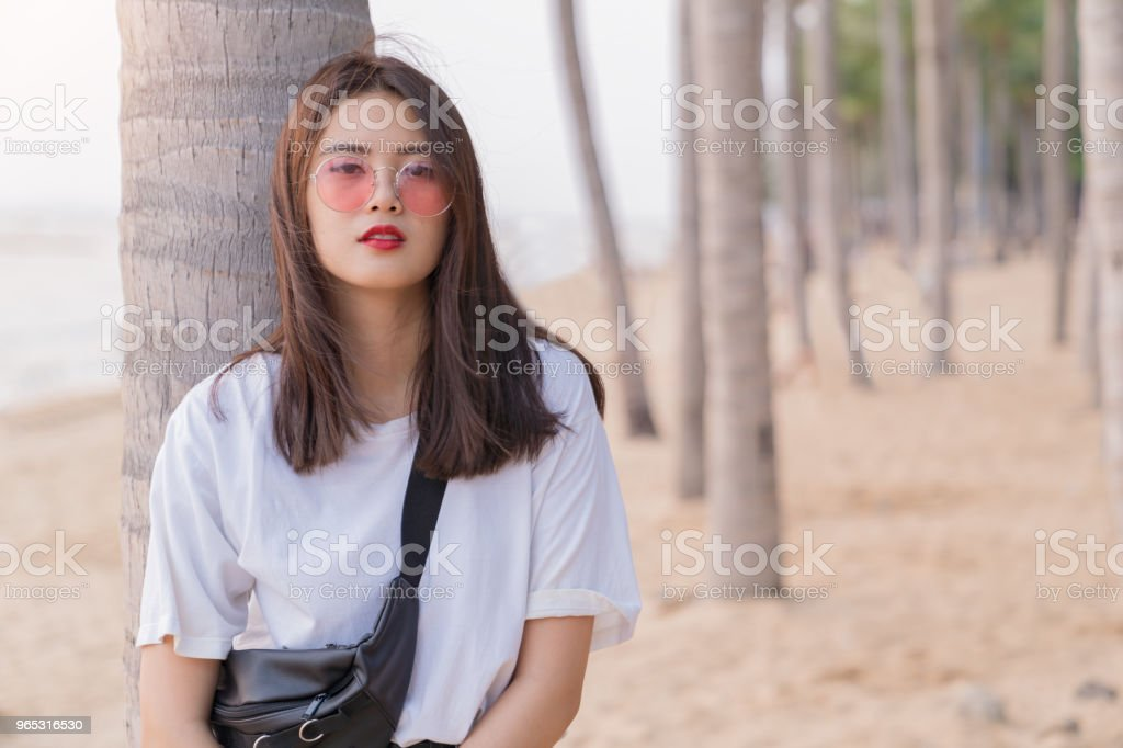 Asian beautiful female young teenager relaxing on the beach background. zbiór zdjęć royalty-free