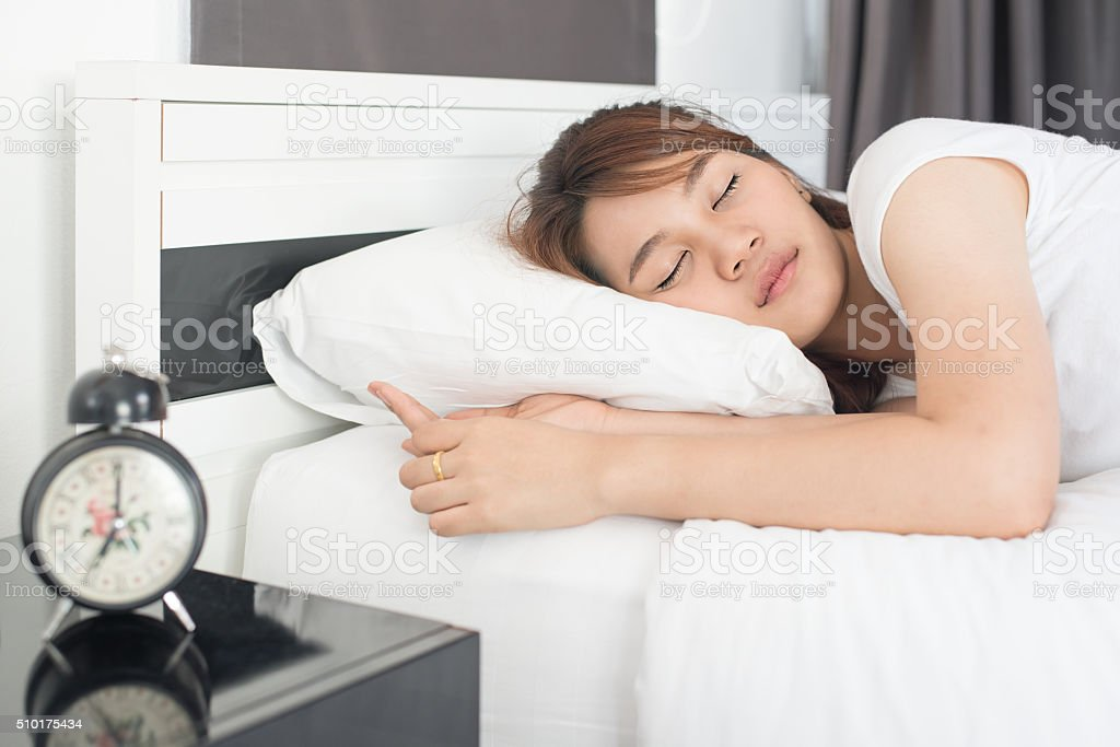 Asian beautiful girl sleeps in the bedroom stock photo