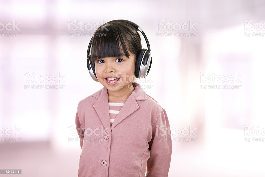 Asian beautiful little girl portrait with headphones royalty-free stock photo