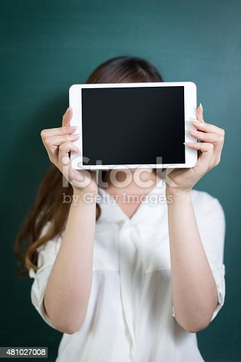 485539628 istock photo asian beautiful woman holding tablet in front of blackboard 481027008