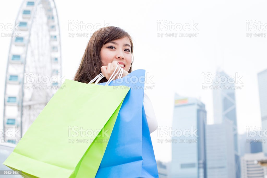 asian beautiful woman shopping and holding bags  portrait royalty-free stock photo