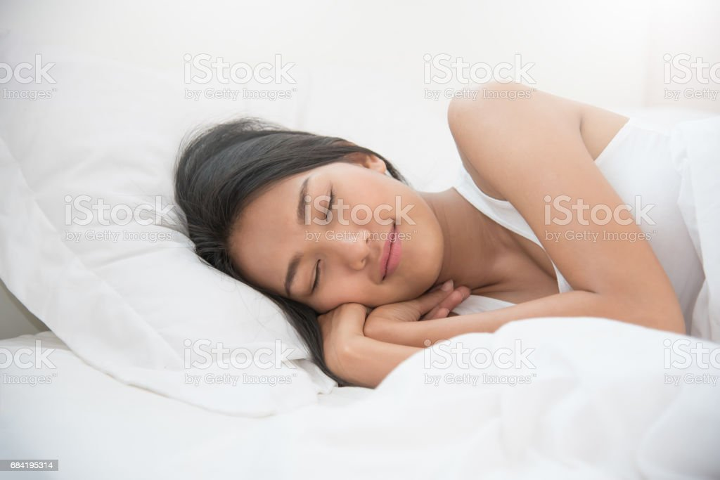 Asian beautiful woman sleeping on her bed. royalty-free stock photo