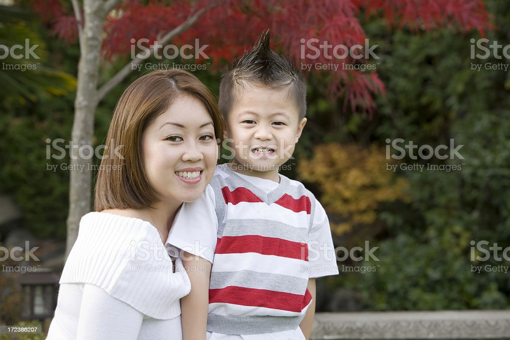 Asian Beautiful Young Mother Posing with Son Outdoors, Copy Space royalty-free stock photo