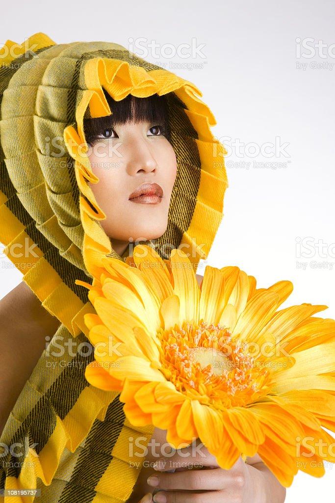 Asian Beautiful Young Woman Fashion Model Wearing Scarf, Holding Sunflower royalty-free stock photo