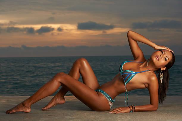 Asian Beauty at Sunrise Beach stock photo