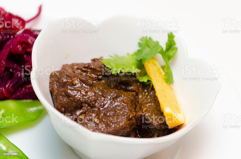 Asian Beef with Red Cabbage and Snow Peas stock photo