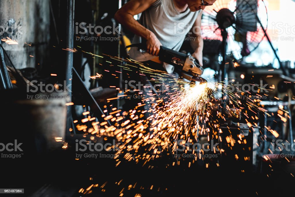 Asian blacksmith working with a grinder - Royalty-free 30-39 Years Stock Photo