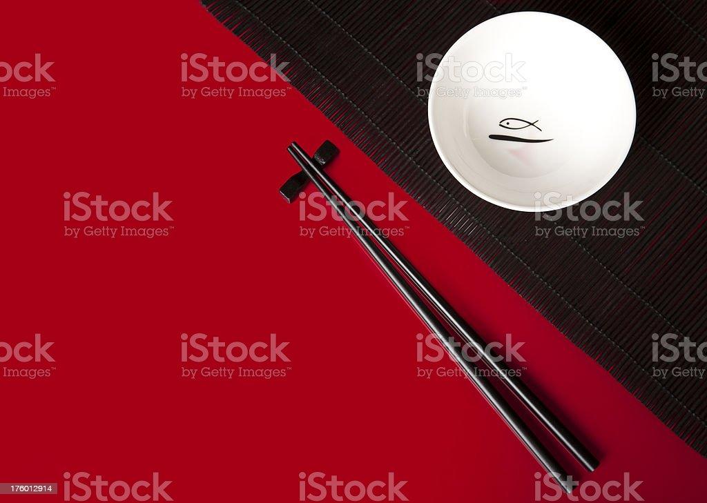 Asian bowl, straw mat and chopsticks royalty-free stock photo