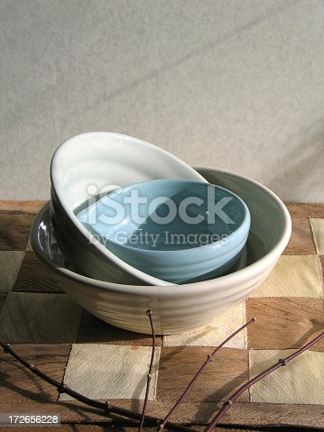 Asian bowls shot on bamboo mat