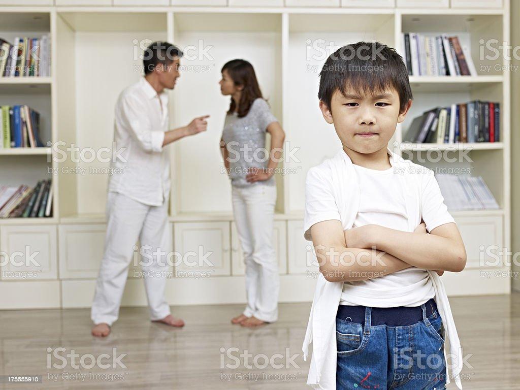 asian boy and quarreling parents stock photo